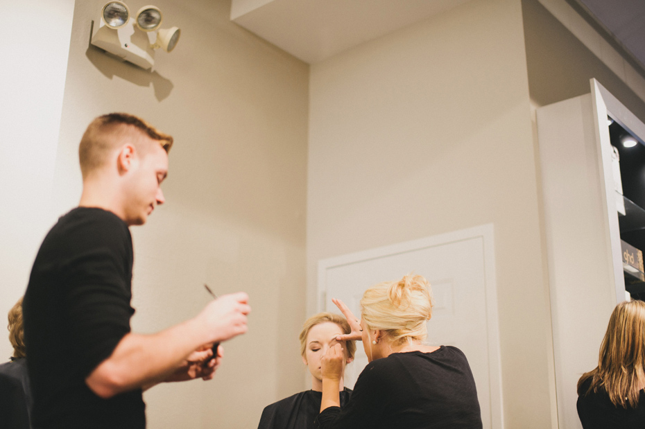 A bride gets her makeup done at Salon Vox in Ann Arbor by Wedding Photographer Heather Jowett.