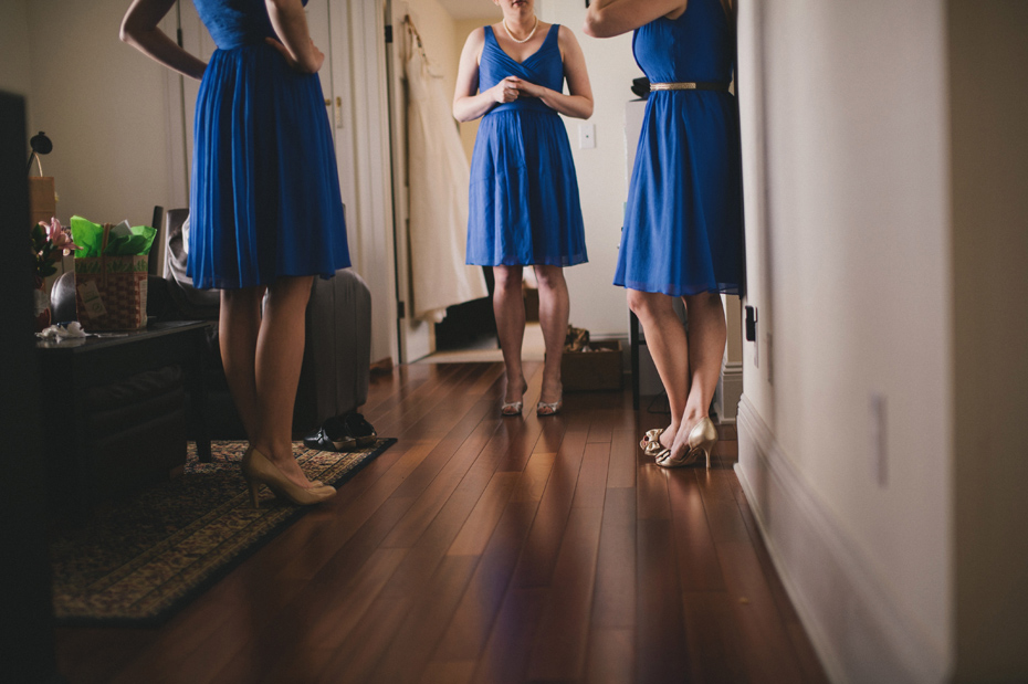 Bridesmaids get dressed at a private home in Ann Arbor, shot by wedding photographer Heather Jowett