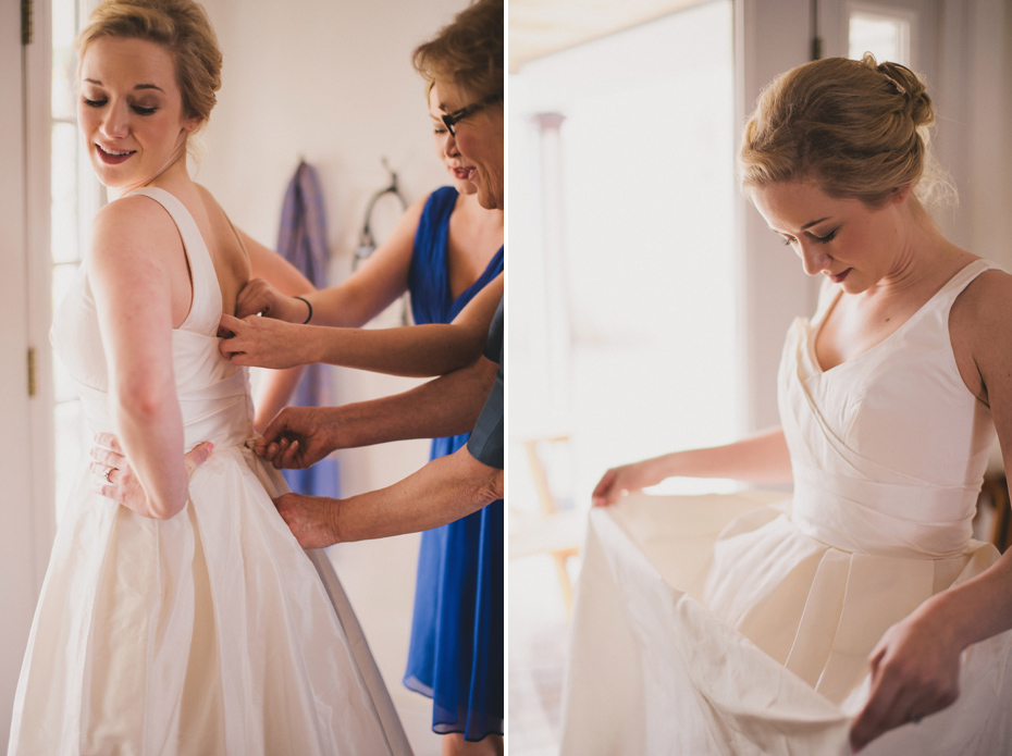 A mother helps a bride into her dress at a private home in Ann Arbor, shot by wedding photographer Heather Jowett