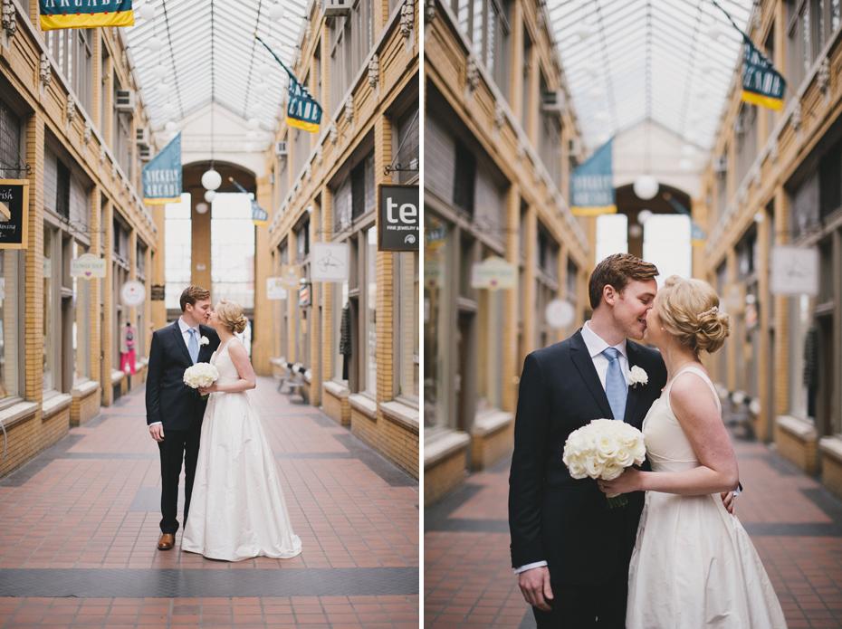 A bride and groom share a first look in Nichol's arcade in Ann Arbor, shot by wedding photographer Heather Jowett