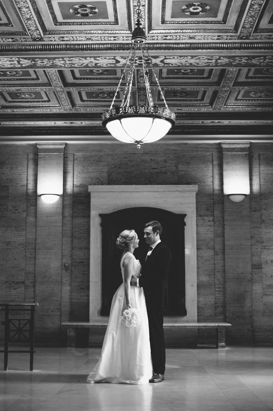 A bride and groom portrait at Angell Hall in Ann Arbor, shot by wedding photographer Heather Jowett