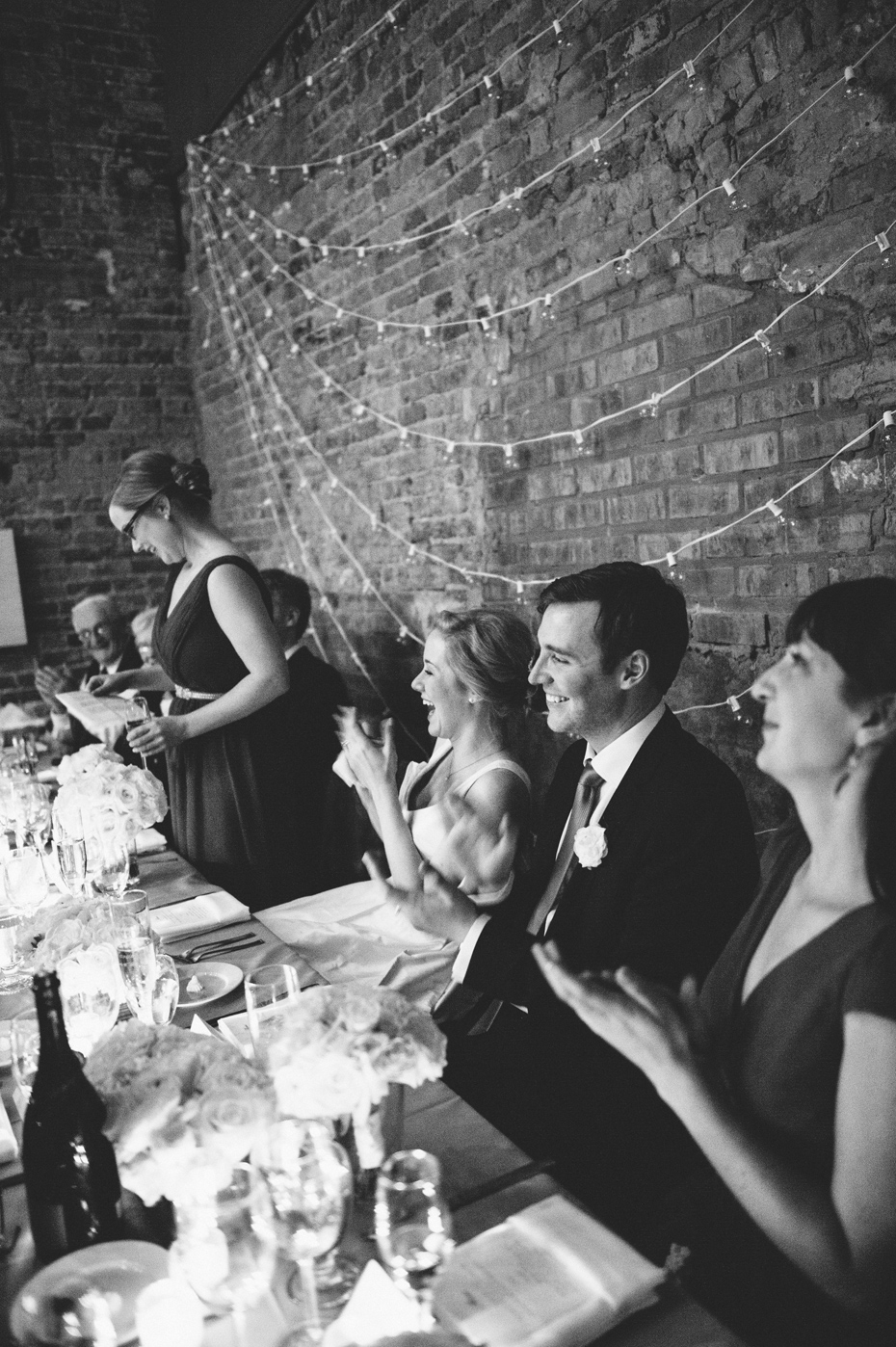 The sisters of the bride and groom share a toast during a wedding reception at Zingerman's Events on Fourth, in Ann Arbor, by Wedding Photographer Heather Jowett