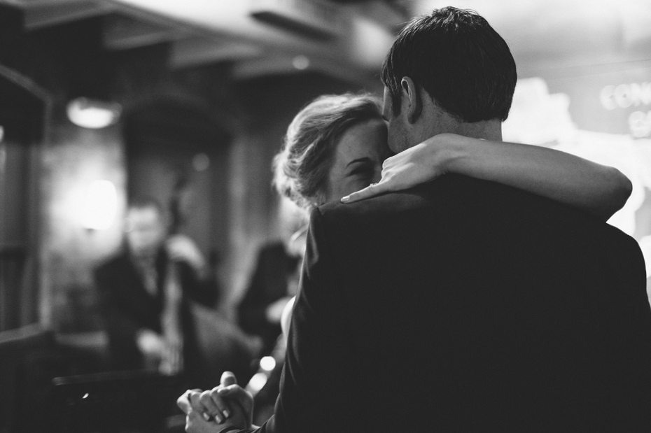 The bride and groom share their first dance during a wedding reception at Zingerman's Events on Fourth, in Ann Arbor, by Wedding Photographer Heather Jowett