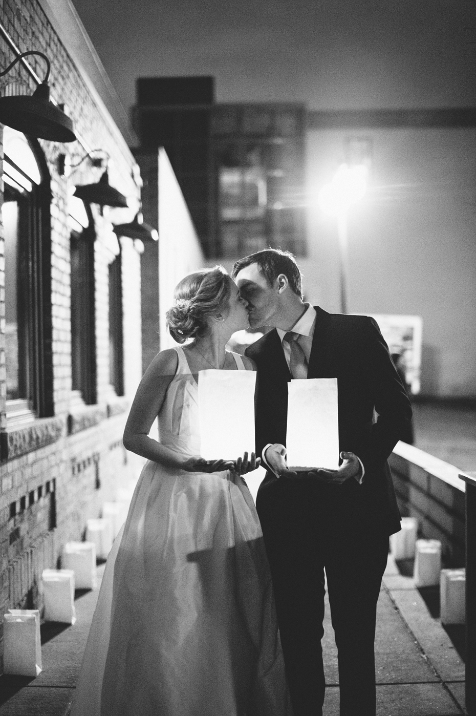 The bride and groom share one last kiss during a wedding reception at Zingerman's Events on Fourth, in Ann Arbor, by Wedding Photographer Heather Jowett