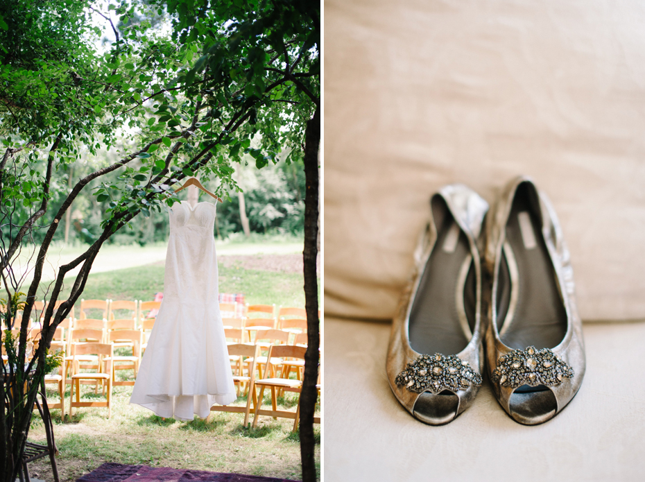 A bride's wedding dress hangs in a tree before her wedding ceremony in this photograph by Ann Arbor Michigan wedding photographer, Heather Jowett.