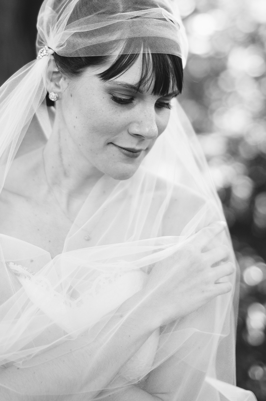 Black and white Bridal portraits with a bride wearing a vintage styled veil by Ann Arbor Michigan wedding photographer, Heather Jowett.