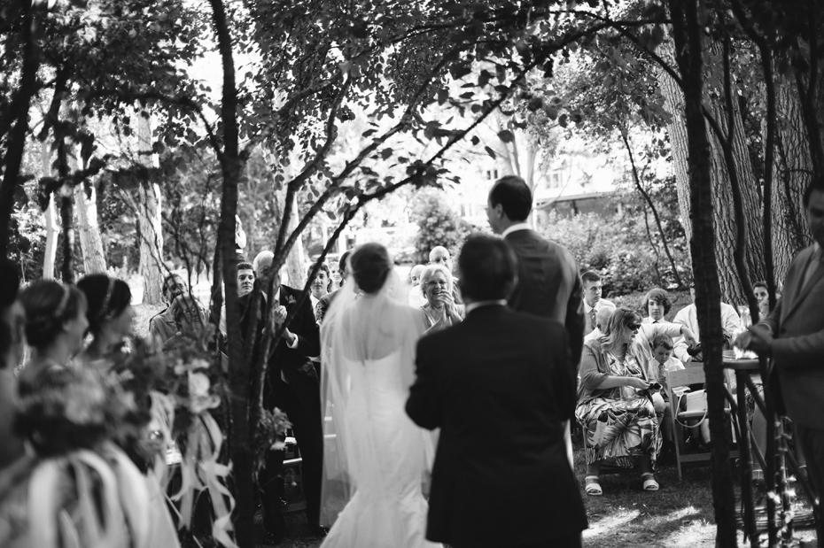 The crowd cheers during A backyard wedding by Detroit Michigan wedding photographer, Heather Jowett.