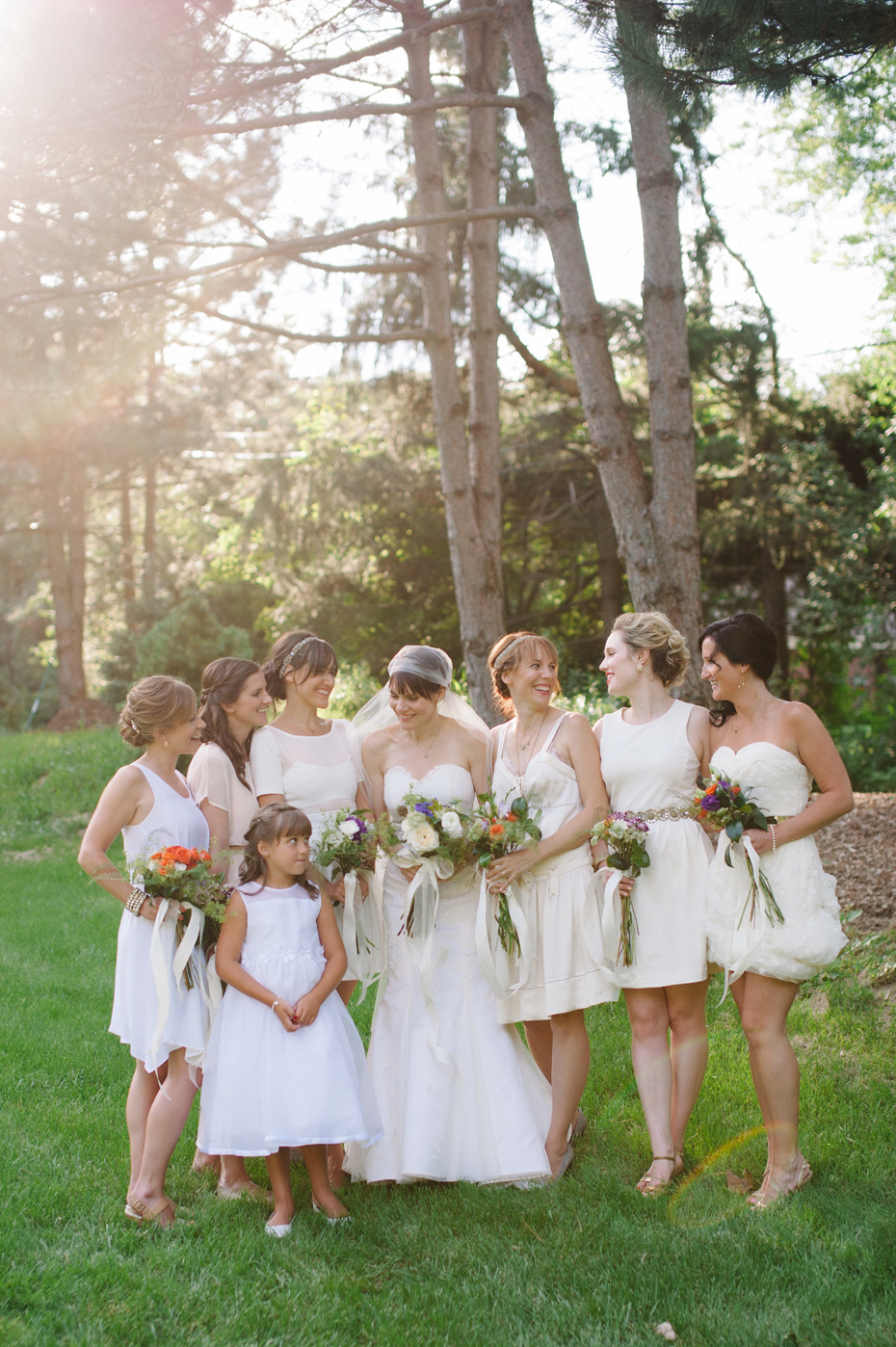Bridesmaids with the bride and their vintage hand tied bouquets by Detroit Michigan wedding photographer, Heather Jowett.