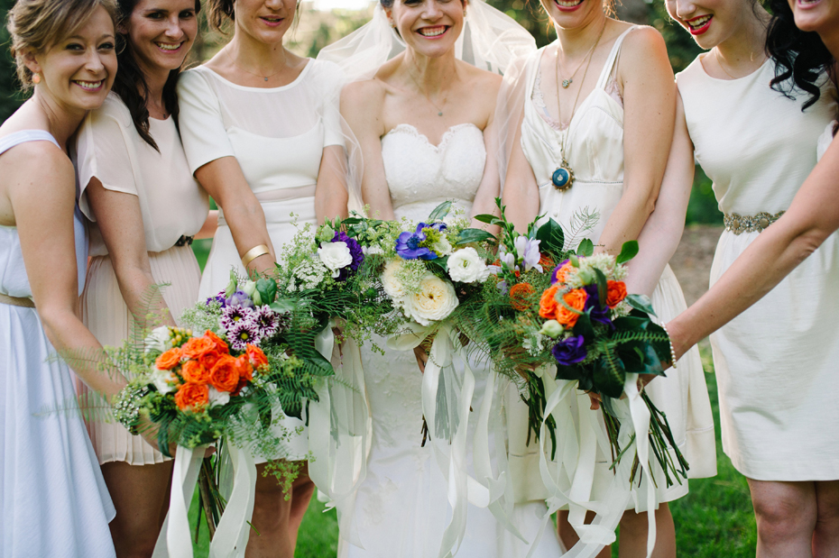 Brightly colored hand tied bouquets by Detroit Michigan wedding photographer, Heather Jowett.