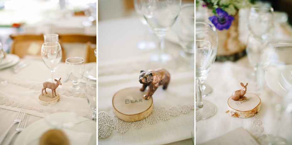 Woodland creatures painted gold serve as DIY table numbers at a backyard wedding reception by Ann Arbor Michigan wedding photographer, Heather Jowett.