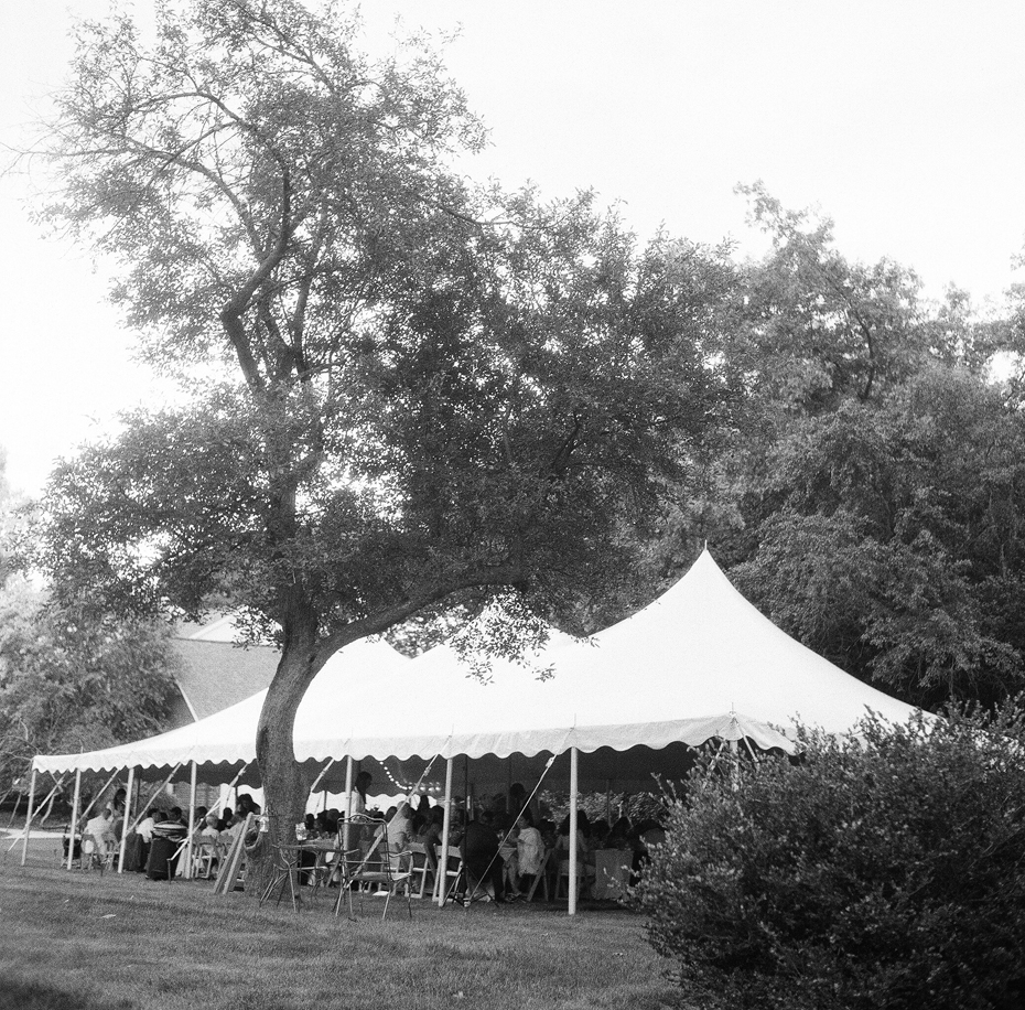 The tent at a backyard wedding reception photographed on black and white film using a vintage rolleiflex by Ann Arbor Michigan wedding photographer, Heather Jowett.