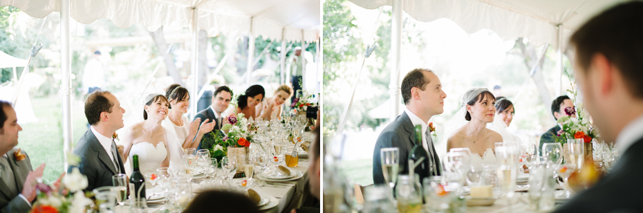 Bride and groom react to the father of the bride's toast at a backyard wedding reception by Ann Arbor Michigan wedding photographer, Heather Jowett.