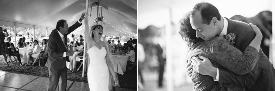 bride and groom dance with their parents at their backyard wedding reception by Ann Arbor Michigan wedding photographer, Heather Jowett.