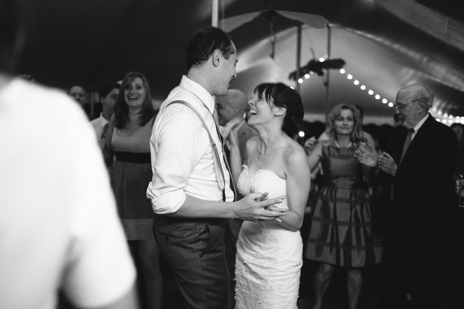 Bride and groom dancing at a backyard wedding by Bloomfield Hills wedding photographer Heather Jowett.