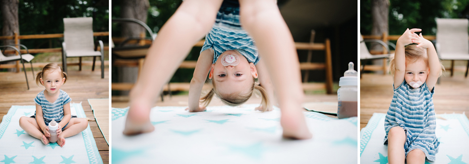 A 2 year old shows off her yoga skills during a lifestyle family portrait session in Ferndale photographed by Ann Arbor Wedding Photographer, Heather Jowett.