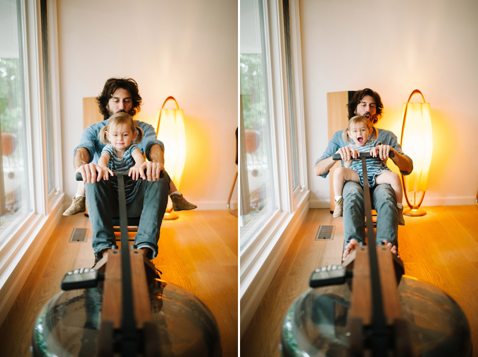 A two year old and her father play on a mid-century style rowing machine during a documentary family portrait session in Ferndale photographed by Ann Arbor Wedding Photographer, Heather Jowett.