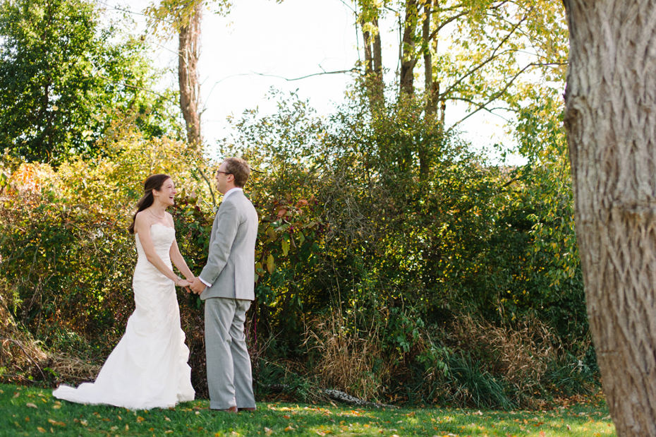 Bride and groom sharking a first look at Misty Farms in Ann Arbor Michigan.