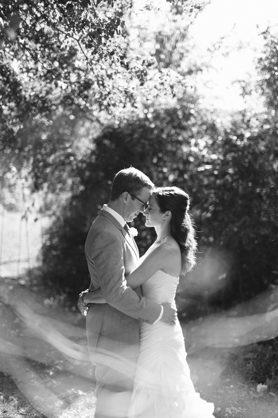 Black and white bride and groom portrait at Misty Farms by photojournalistic Michigan wedding photographer Heather Jowett.