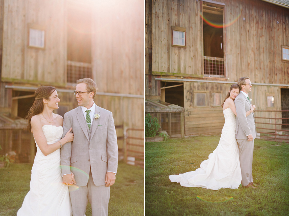 Bride and groom pose by the barn at Misty Farms by photojournalistic Michigan wedding photographer Heather Jowett.