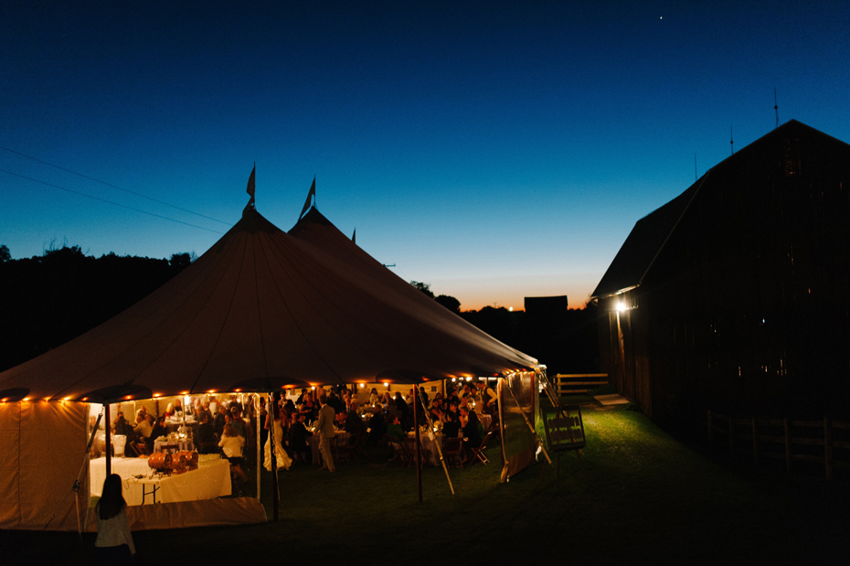 The tent and the sunset at a wedding reception at Misty Farms by photojournalistic Michigan wedding photographer Heather Jowett.
