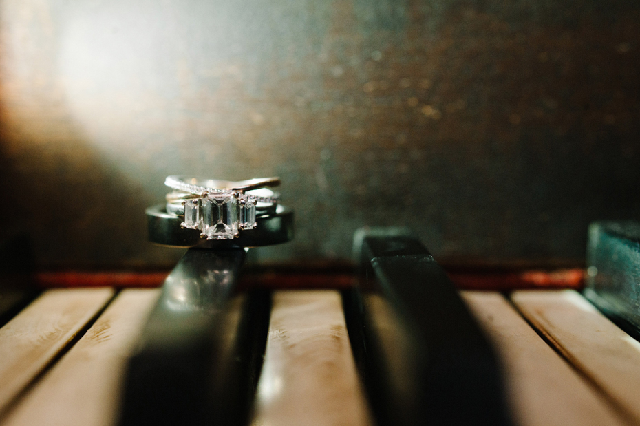 Wedding rings on a piano at Misty Farms.