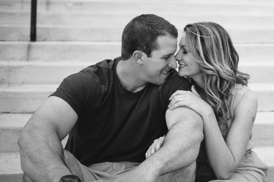 A couple snuggles up during their engagement session in Port Huron Michigan.