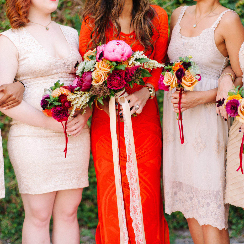 Brightly colored florals in jewel tones at the Sundy house in southern florida by wedding photographer Heather Jowett.