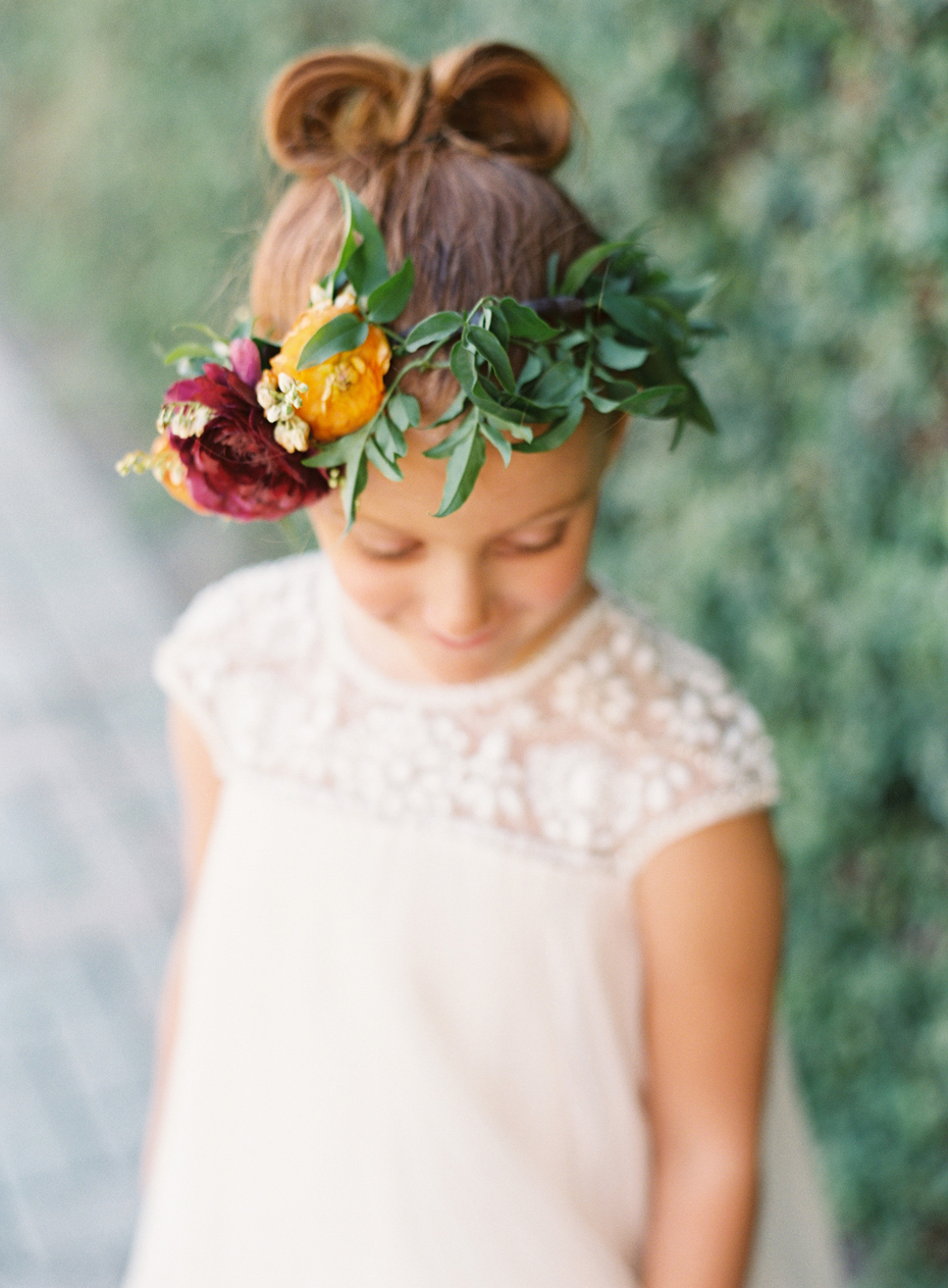 Floral girl in floral crown at the Sundy house in southern florida by wedding photographer Heather Jowett.