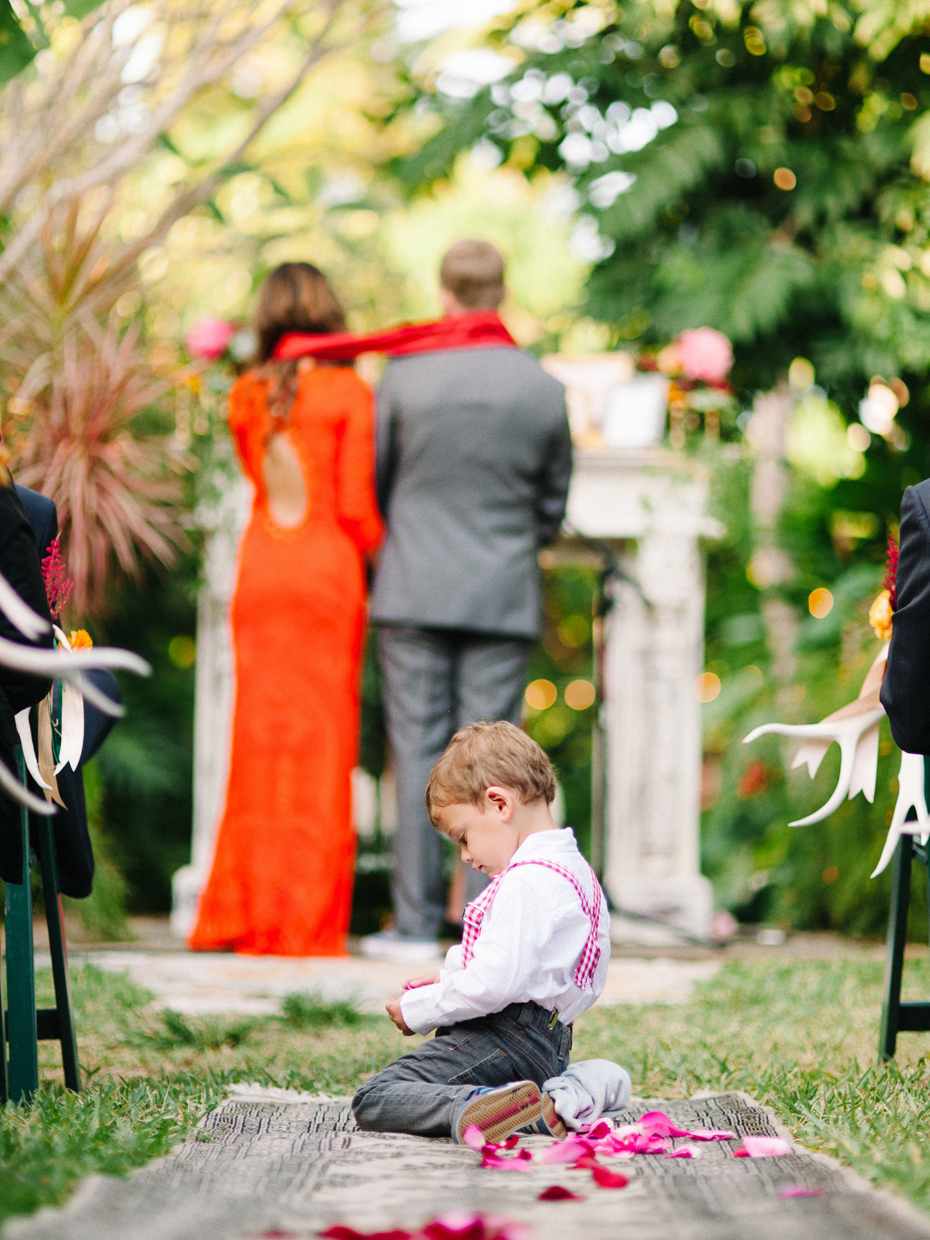 The ring bearer takes a break during A wedding ceremony at the Sundy house.