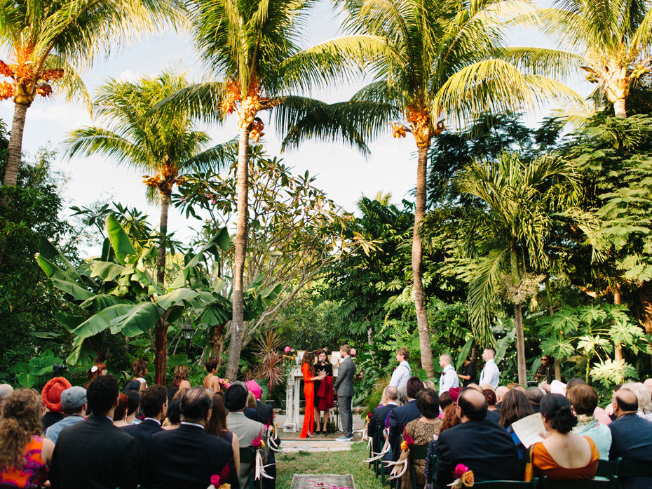 Palm trees look over A wedding ceremony at the Sundy house.