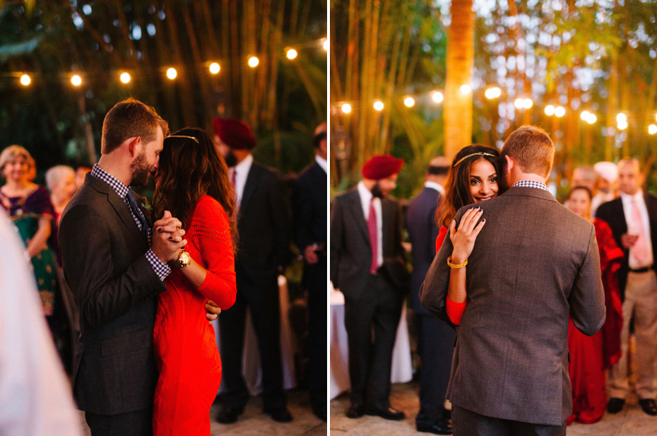 The bride and groom share a first dance under patio lights at the Sundy House in Southern Florida by wedding photographer Heather Jowett.