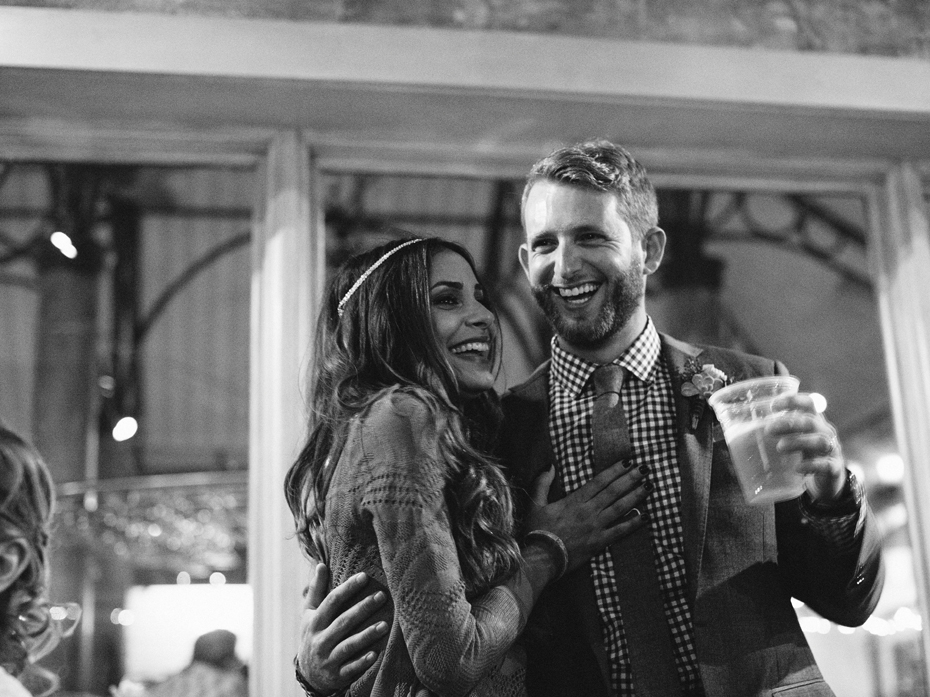 The bride and groom laugh at the father of the bride during toasts at the Sundy House in Southern Florida by wedding photographer Heather Jowett.