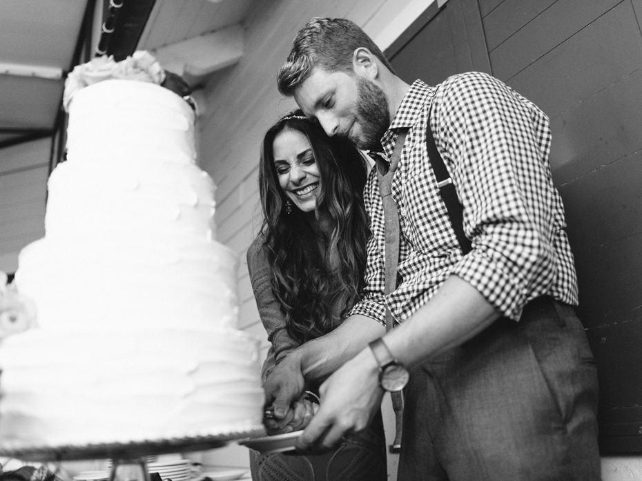 The bride and groom cut the cake at the Sundy House in Southern Florida by wedding photographer Heather Jowett.