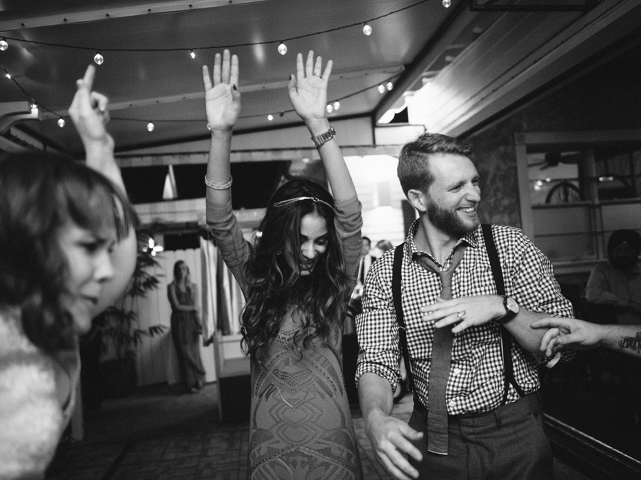 Wedding guests dance the night away at the Sundy House in Southern Florida by wedding photographer Heather Jowett.