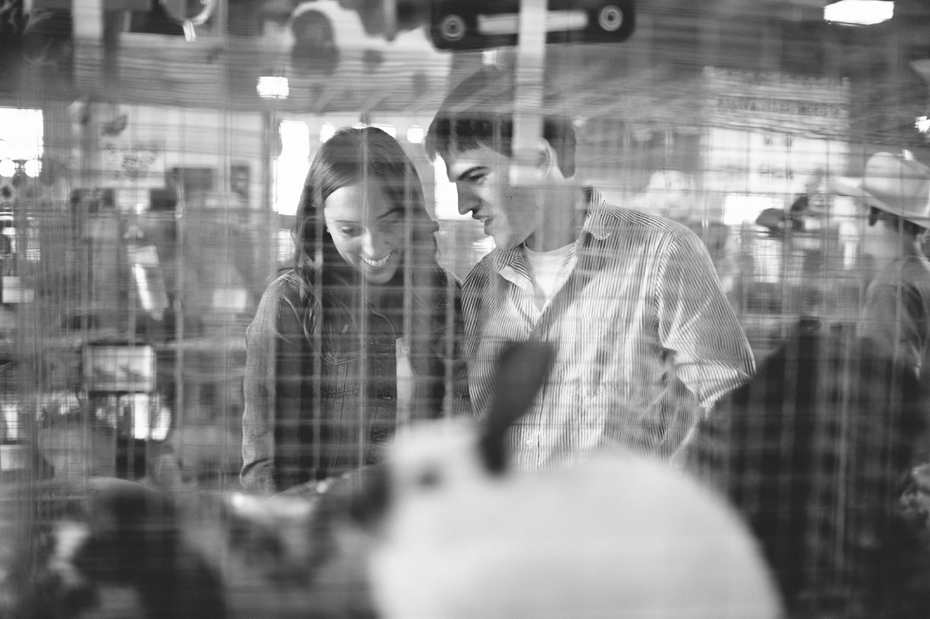 A couple checking out the bunnies at the 4h fair by Michigan wedding photographer Heather Jowett.