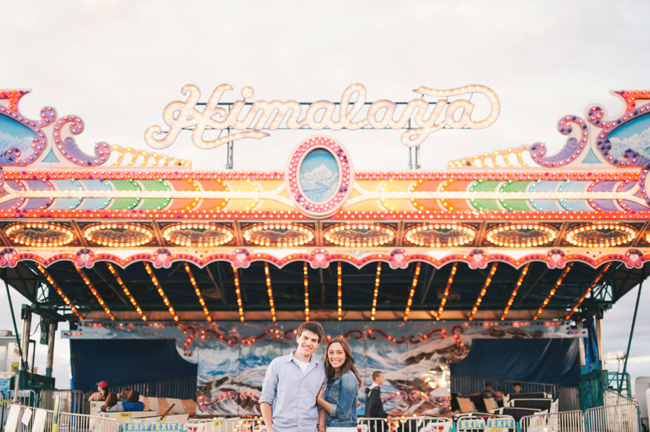 Love at the carnival at the Saint Clair County 4h fair by Michigan wedding photographer Heather Jowett.