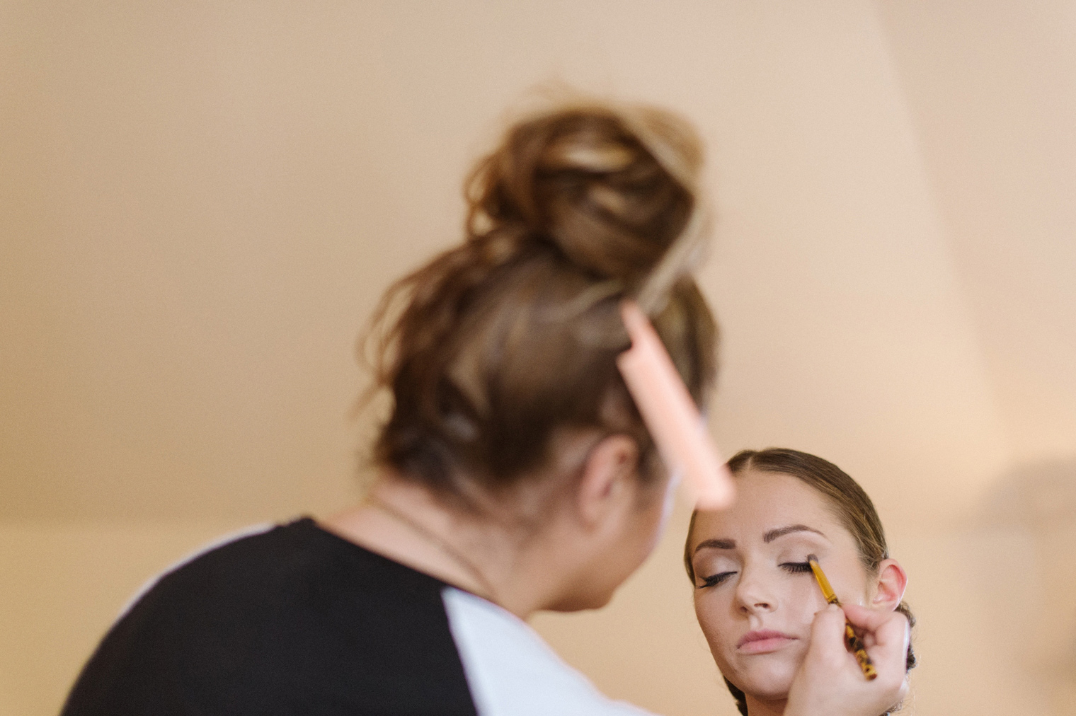 Bride is given last minute touches on her hair and makeup before her Detroit Wedding by photographer Heather Jowett.