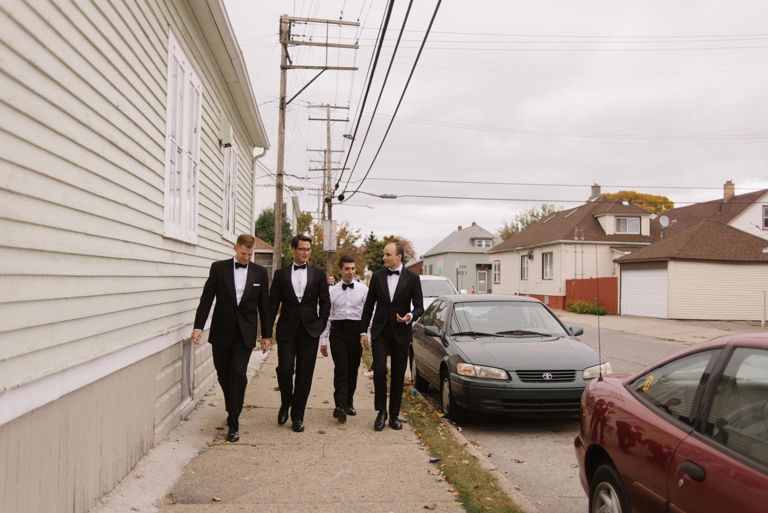 The groom and his groomsmen head to the wedding ceremony on a Detroit wedding day by photographer Heather Jowett.