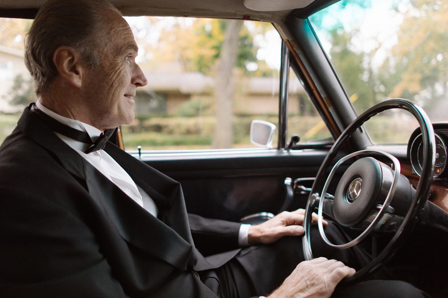 The father of the bride drives his daughter to her wedding ceremony in Detroit.