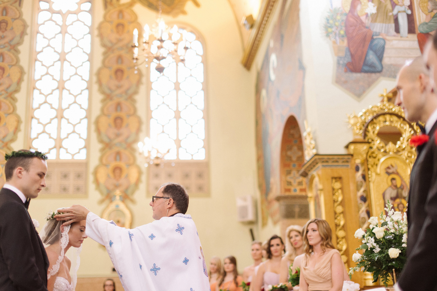 Crowing ceremony during a Ukrainian Orthodox Wedding Ceremony in Hamtramck Michigan by photographer Heather Jowett.