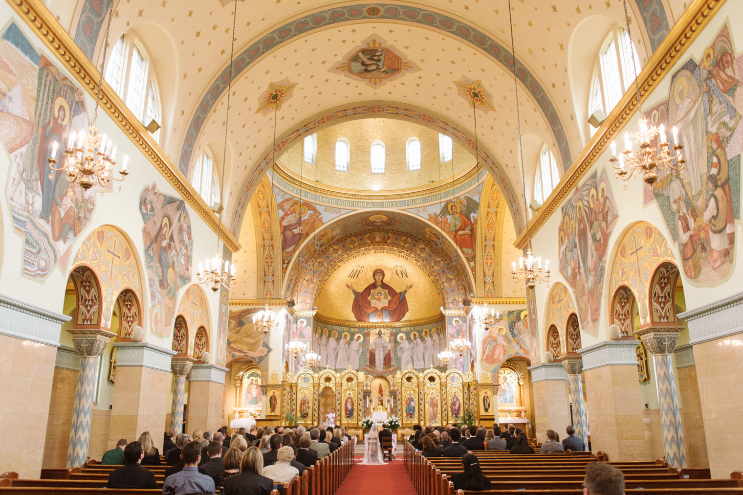 Interior of the sanctuary at Immaculate Conception Ukrainian Rite Catholic Church during a Ukrainian Orthodox Wedding Ceremony in Hamtramck Michigan by photographer Heather Jowett.