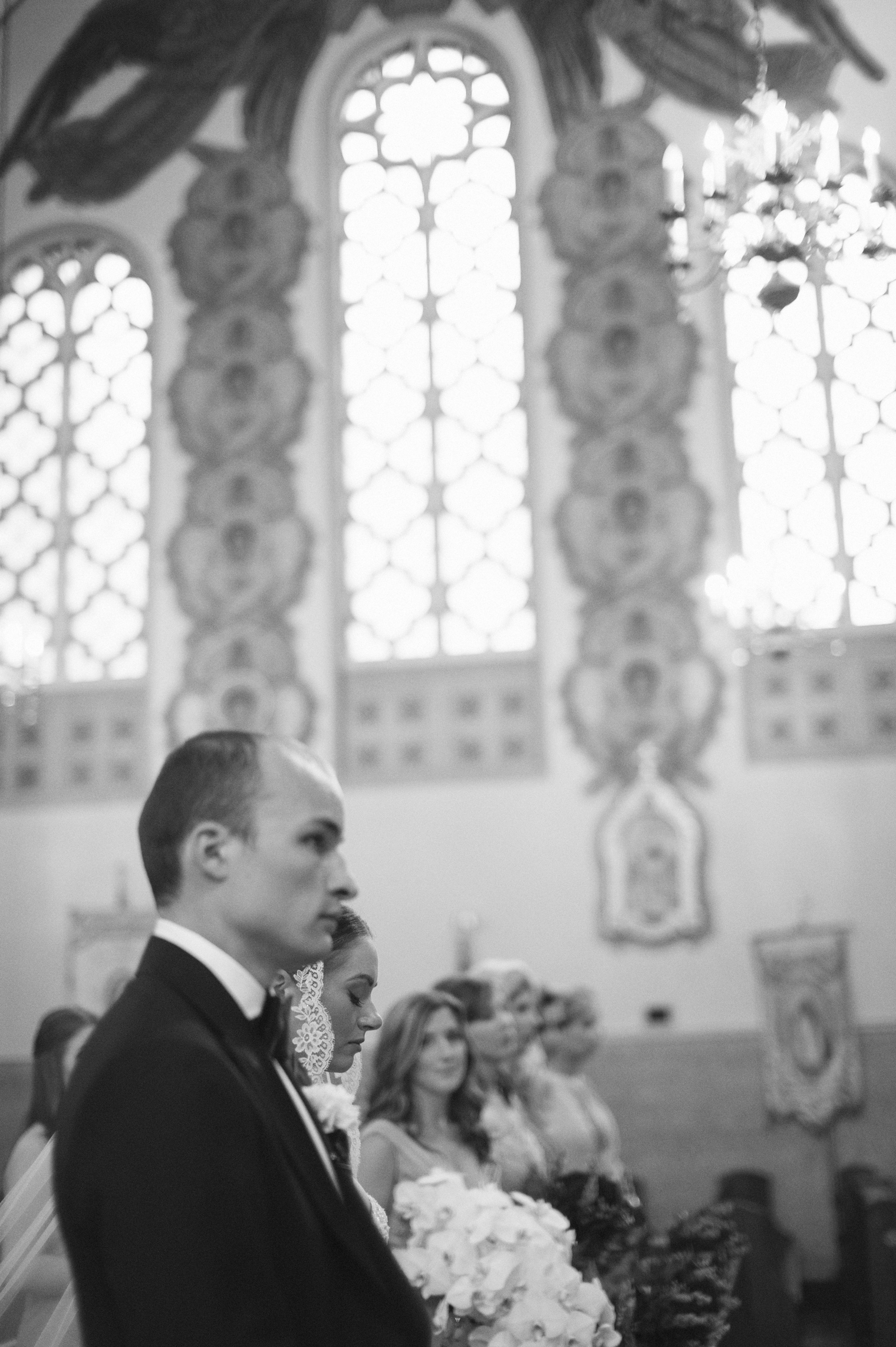 Bride and groom during wedding ceremony at Immaculate Conception Ukrainian Rite Catholic Church in Hamtramck Michigan.