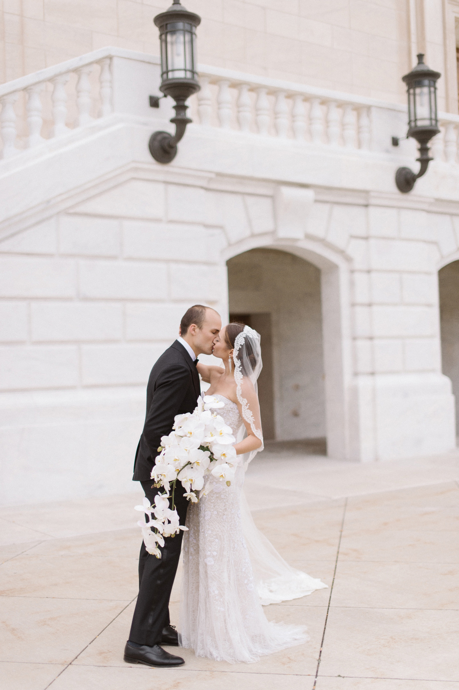 Timeless bride and groom portraits at the Detroit Institute of Arts by Wedding Photographer Heather Jowett.