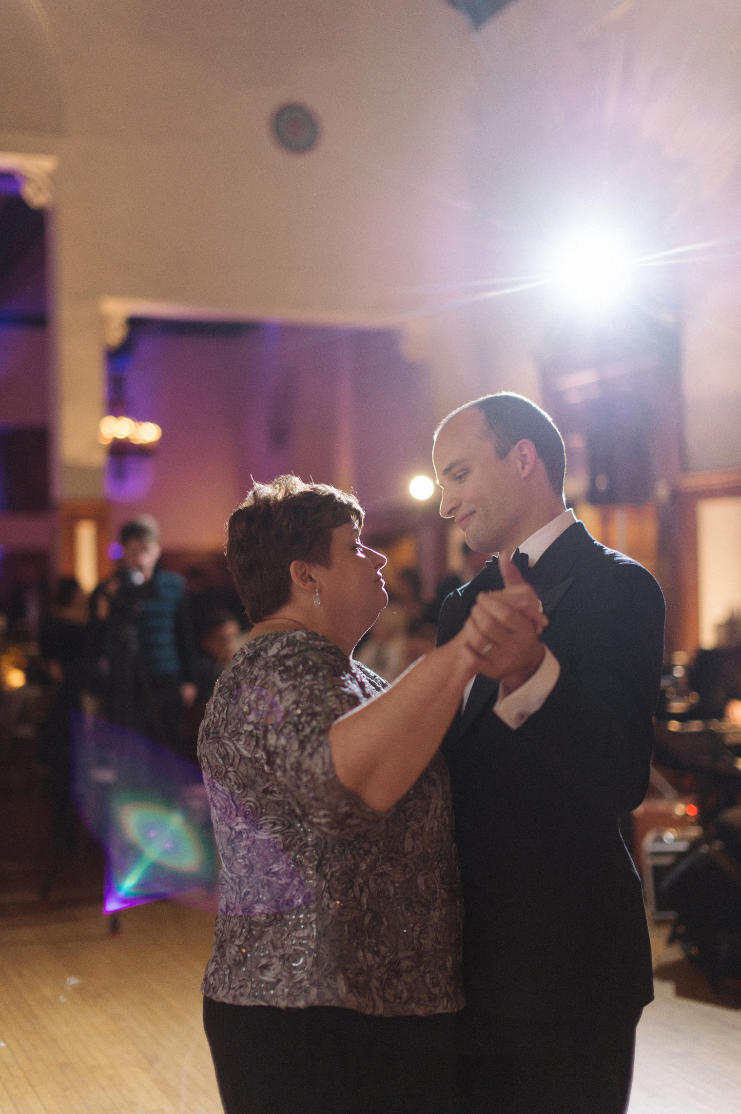 The groom shares a dance with his mother at his Detroit Yacht Club wedding by photographer Heather Jowett.