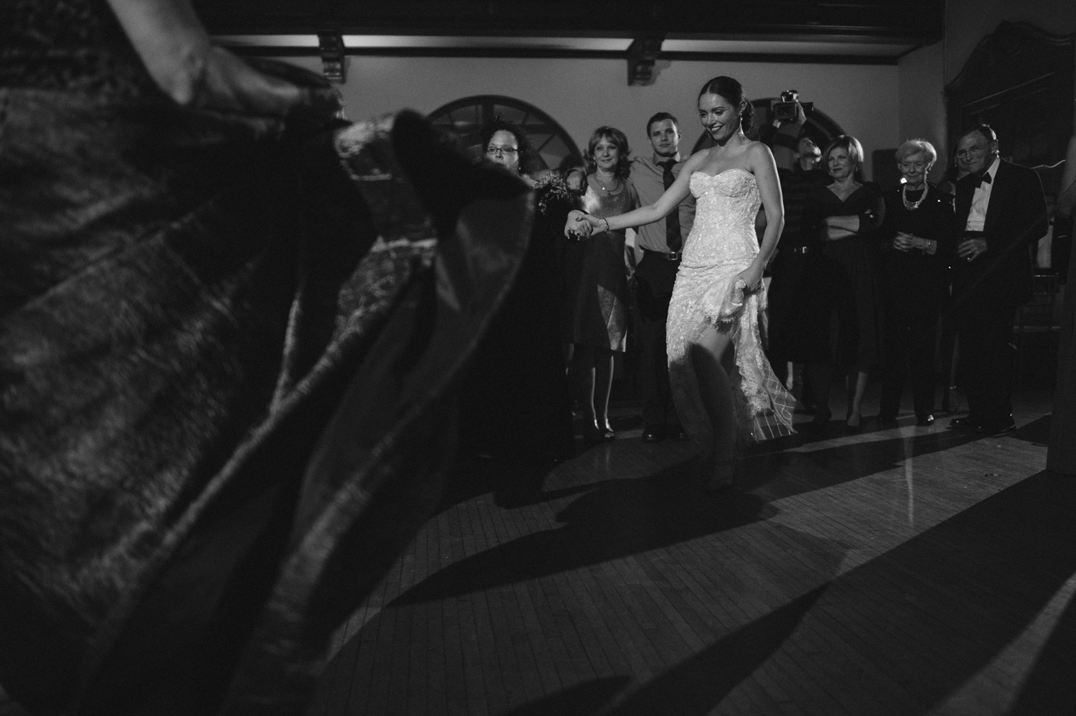 The bride, groom, and guests do traditional Ukrainian dances at a Detroit Yacht Club wedding by Michigan Photographer Heather Jowett.