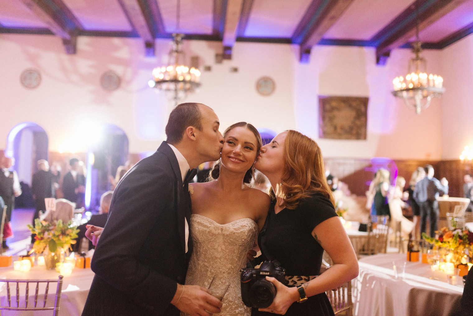 Wedding Photographer Heather Jowett poses with her bride and groom at a Detroit Yacht Club wedding.