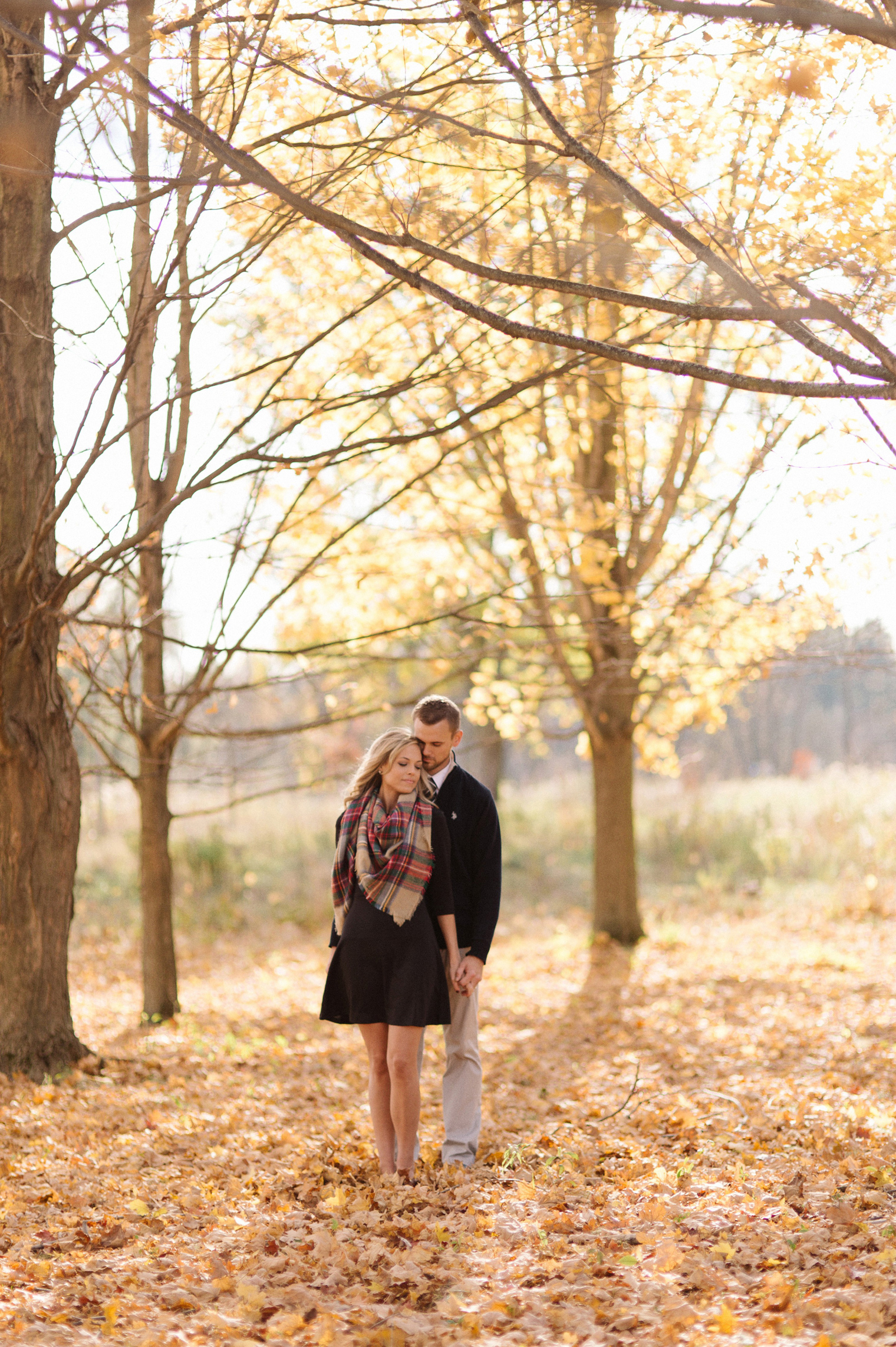 Bright orange and tell fall foliage at a fall couples photography session at the Ann Arbor Botanical Gardens by wedding photographer Heather Jowett