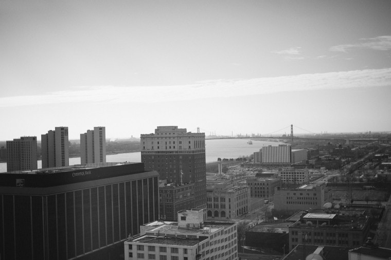 A black and white image of the Detroit Skyline by Michigan wedding photographer Heather Jowett.