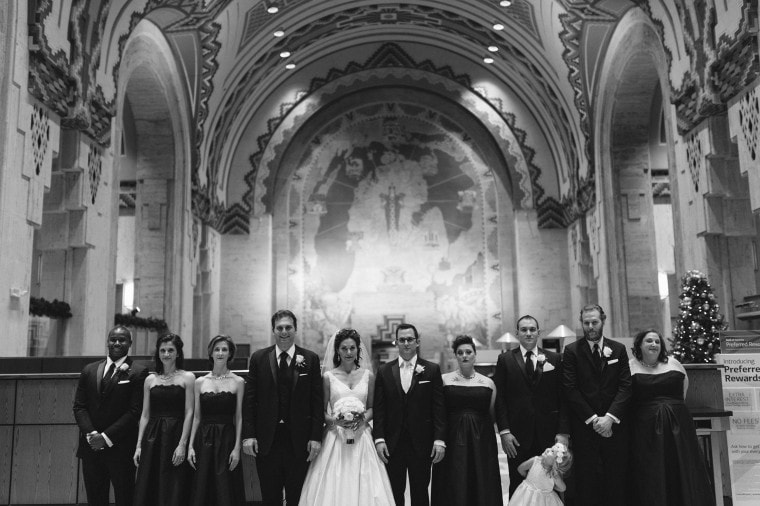 a wedding party poses for a photograph in the Guardian Building in Detroit