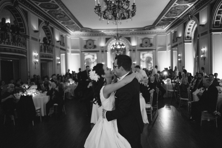 bride and groom share first dance at their Detroit Colony Club wedding by photographer Heather Jowett